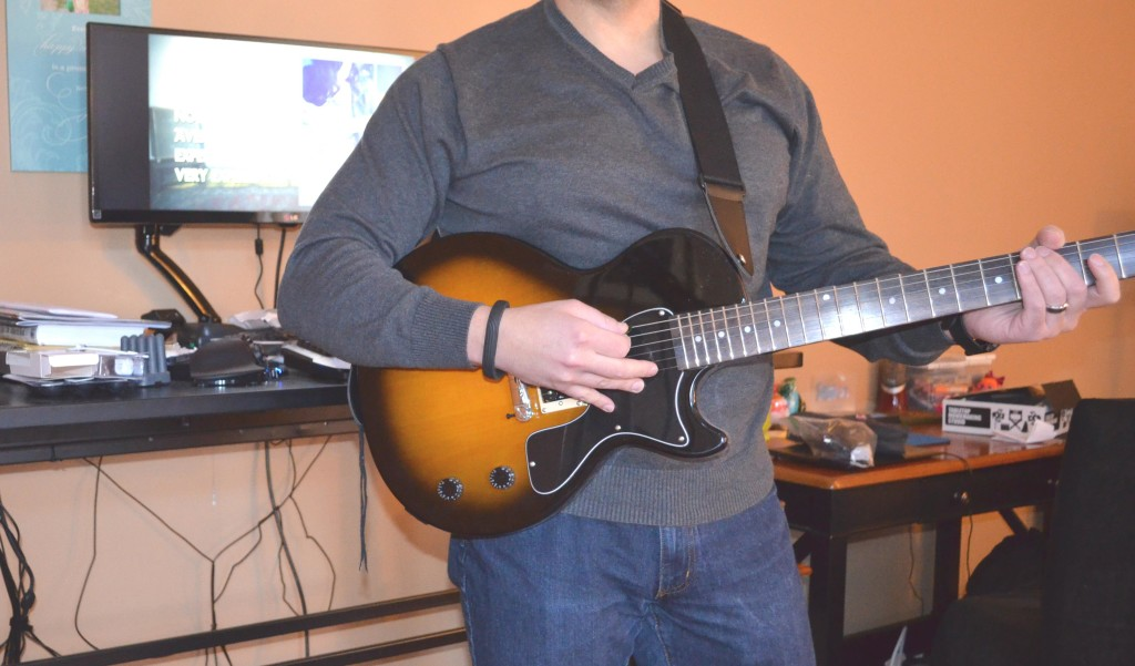 """Your review author """"rocking out"""" with the StrapSnake guitar strap."""