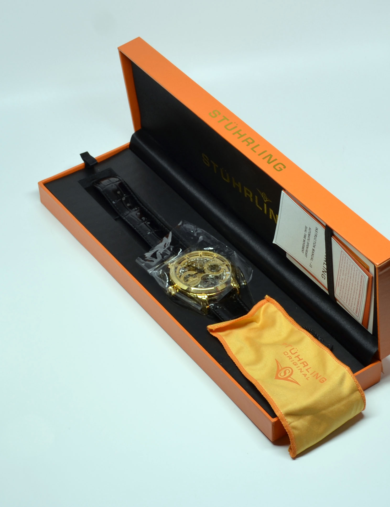 You get the watch, a cleaning cloth, instructions, and warranty and other paperwork.