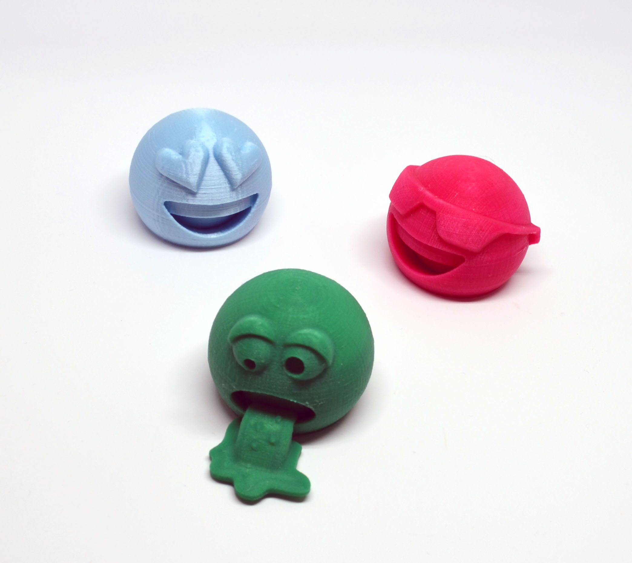 The puke emoji with two of his friends. New Matter's Pearl PLA Arctic Blue filament has great color, and the standard New Matter Pink is also nice, but neither matches the smoothness of AIO Robotics filament.