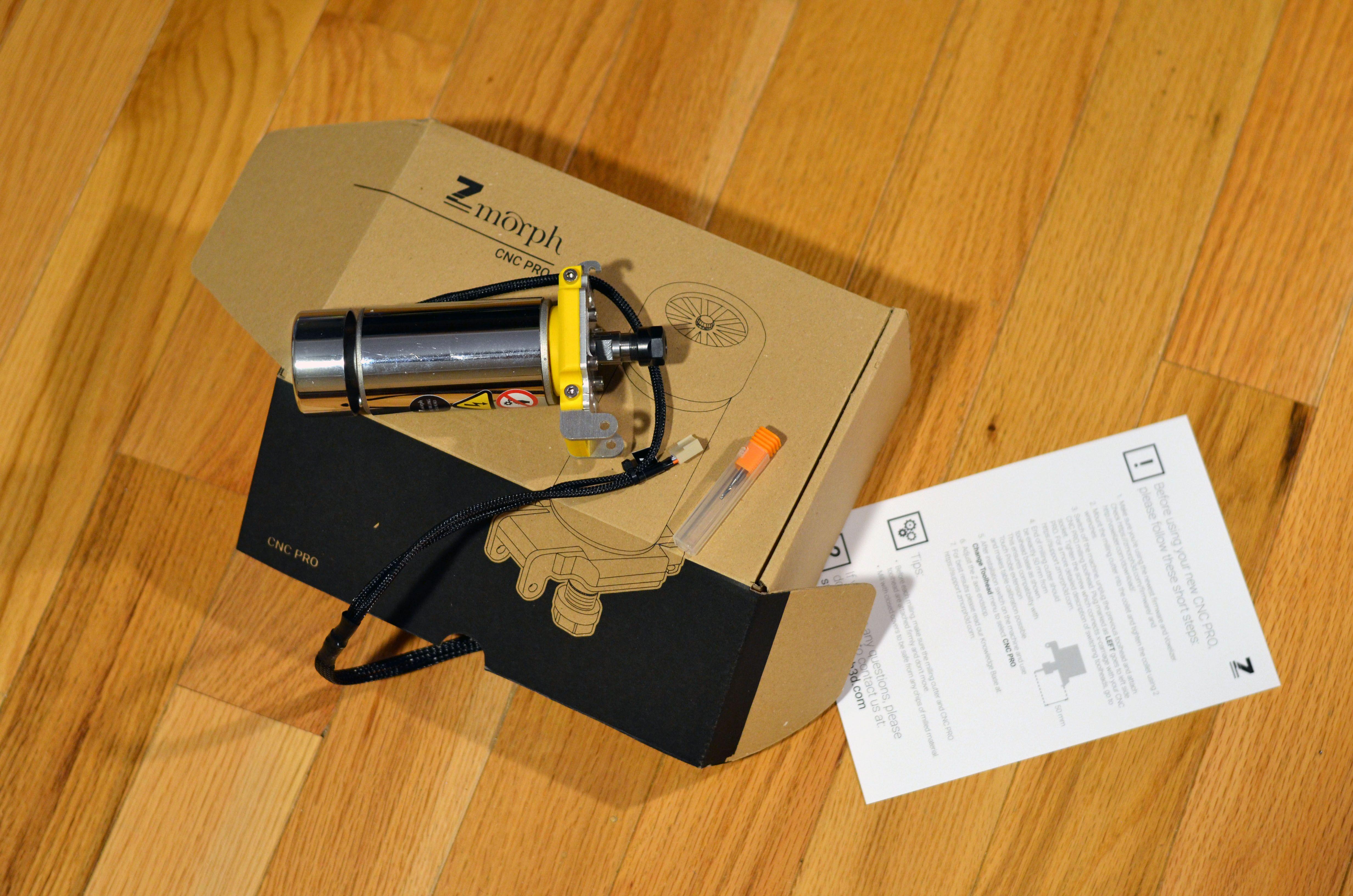Contents of the CNC Pro toolhead box. It has a carbide bit single flute (2mm).