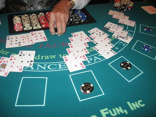 Blackjack dealer in action. Source: Flickr.com