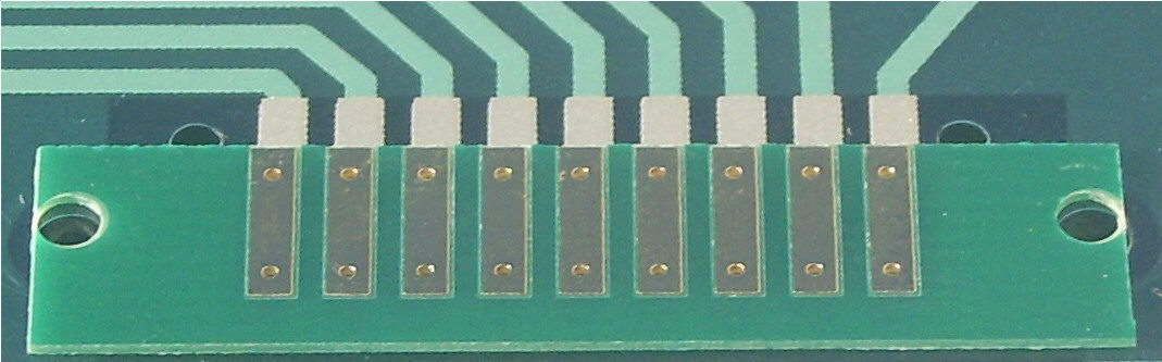 This small PCB goes between the mylar and the circuit board.