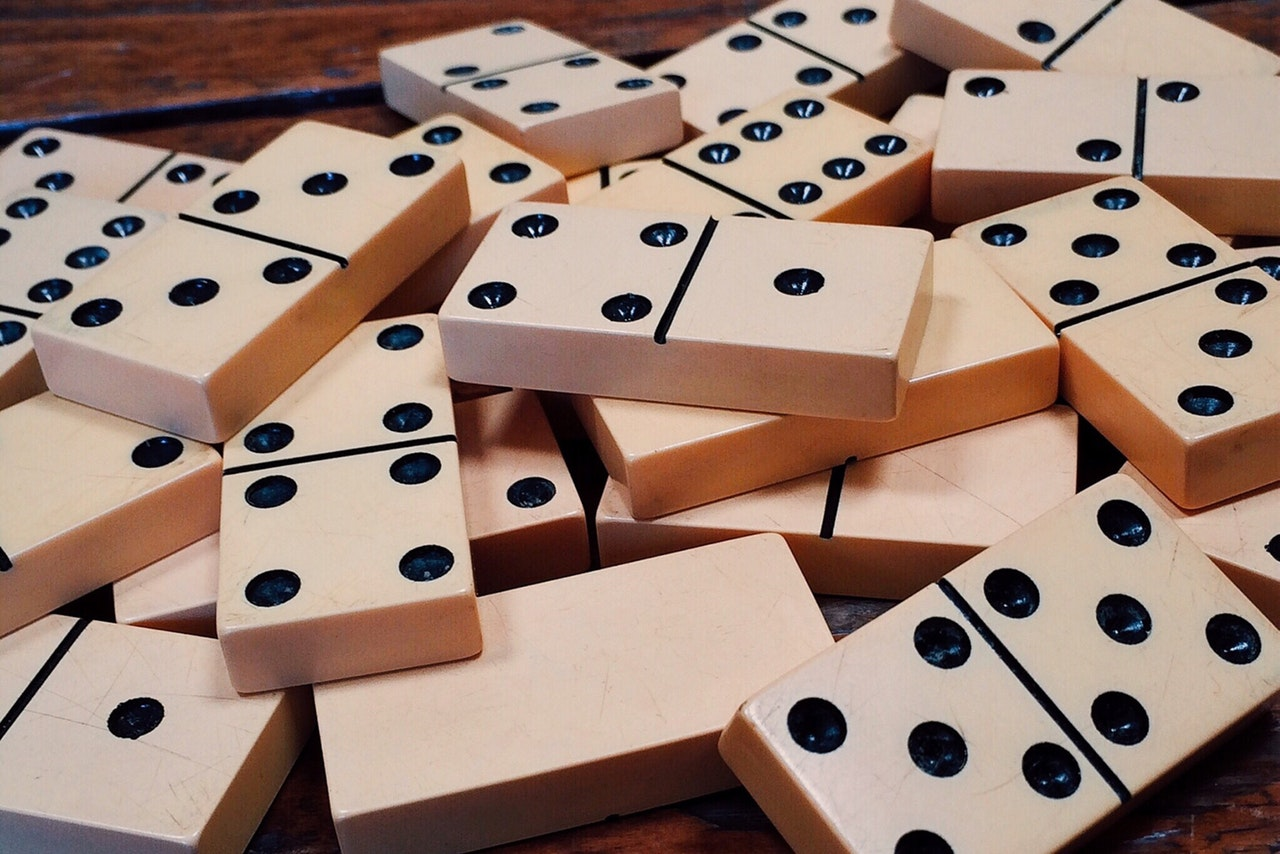 Dominoes features several variations.