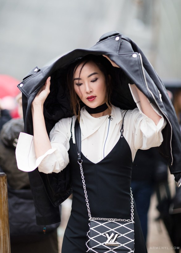 Chriselle Lim in the rain at Louis Vuitton show in Paris Street style at Louis Vuitton FW 16 show in Paris on March 9th photographed by Armenyl.com
