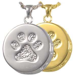 Round pendant with bones embossed around outside edge and paw print on front