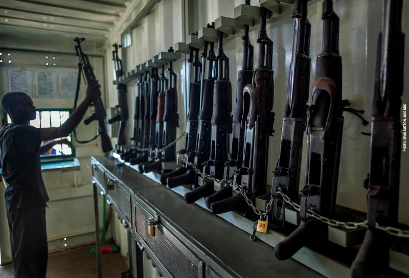Armourer issues a duty weapon in DRC