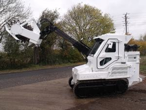 A75T with boom extended and raised
