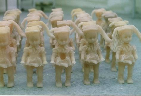 Army of wax flesh coloured dolls.