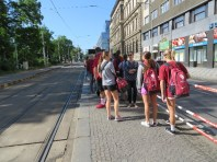 The OU team and tour group wait for the tram near our hotel