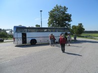 Kathy in front of our tour bus