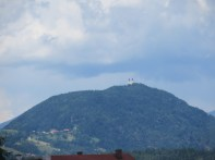 Zoom shot of a church on the mountain near Bled