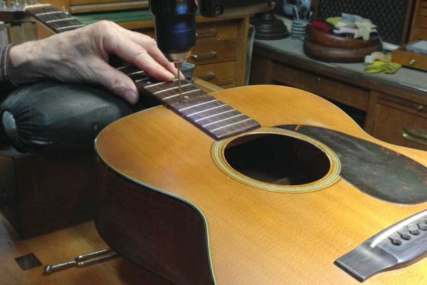 Arnie Gamble reseting the neck on a C. F. Martin guitar.