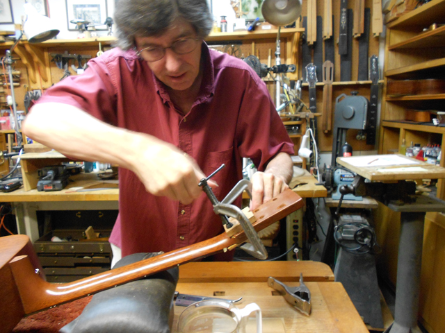 Arnie Gamble repairing a C. F. Martin guitar headstock