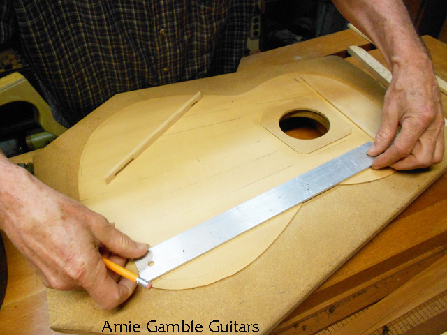 Measuring the braces for the top of the classical guitar.