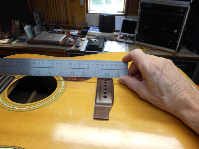 Replacing and regluing the bridge on Martin guitar.