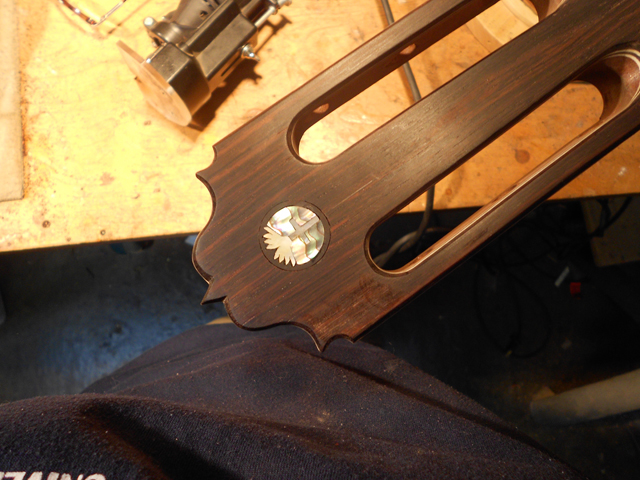Inlay glued in place on the head of the guitar.