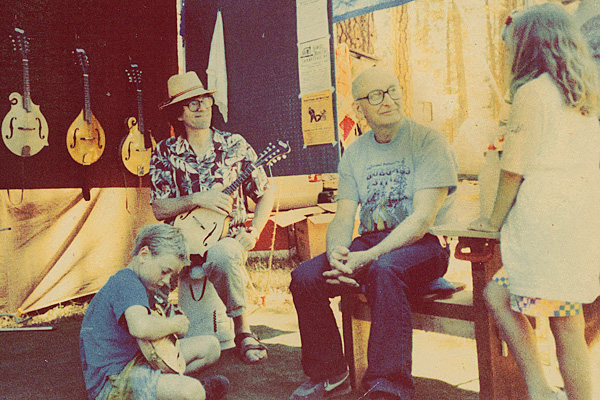 Arnie Gamble at Gil Schlitings booth at the California Bluegrass Festival about 1985.