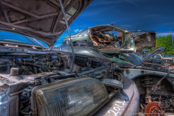 Cars in junkyard - one