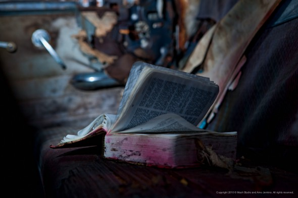 Bible in the backseat pages blowing in the wind