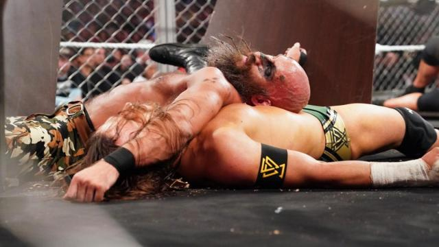 Undisputed ERA's Adam Cole lies under TOmmaso Ciampa having been pinned