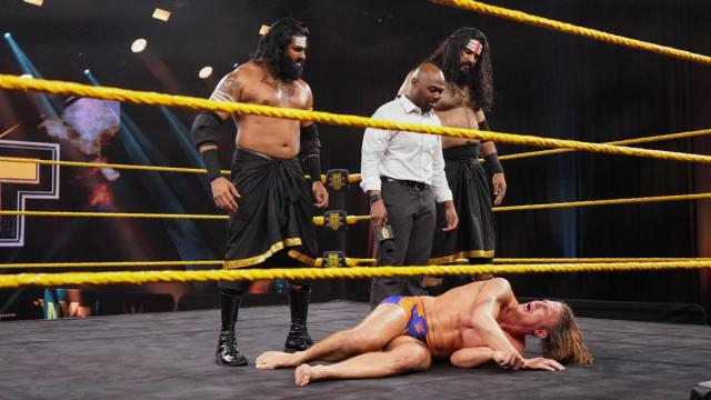 Malcolm Bivens and his new tag team, stand over Matt Riddle