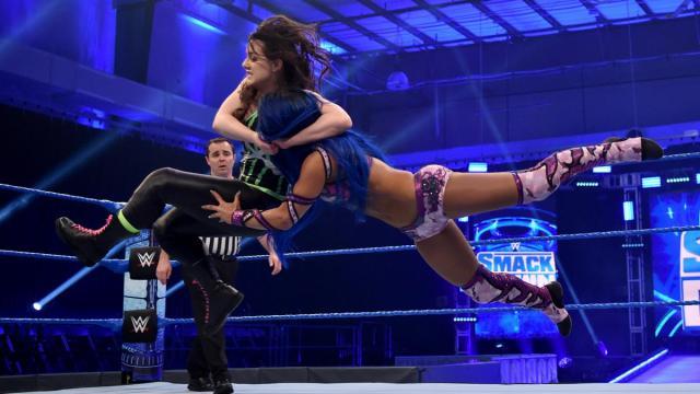 Nikki Cross with a bulldog on Sasha Banks