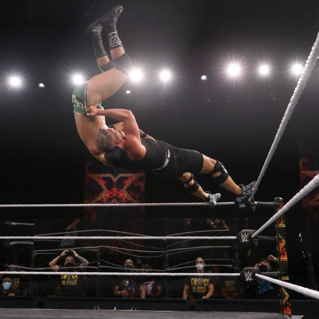 Pat McAfee superplexes Adam Cole from the top turnbuckle