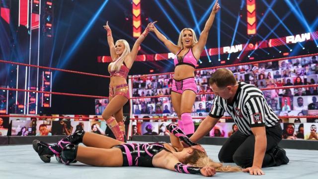 Mandy Rose and Dana Brooke stand over Lana