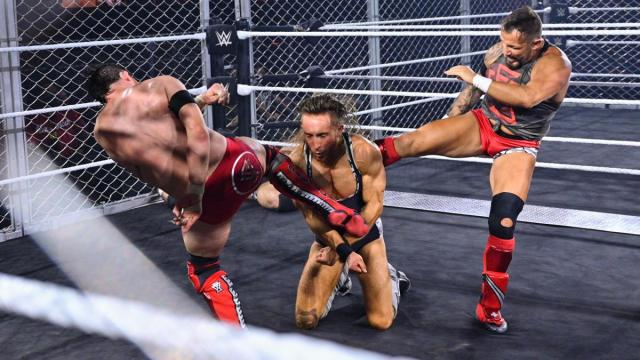 Kyle O'Reilly and Bobby Fish double team Pete Dunne