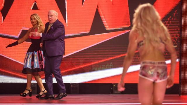 Ric Flair ushers Lacey Evans away as Charlotte Flair approaches