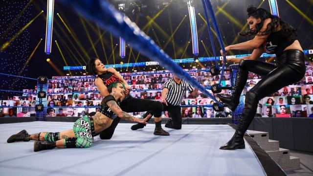 Billie Kay tries to push the rope closer to Ruby Riott to free herself from Bayley's submission