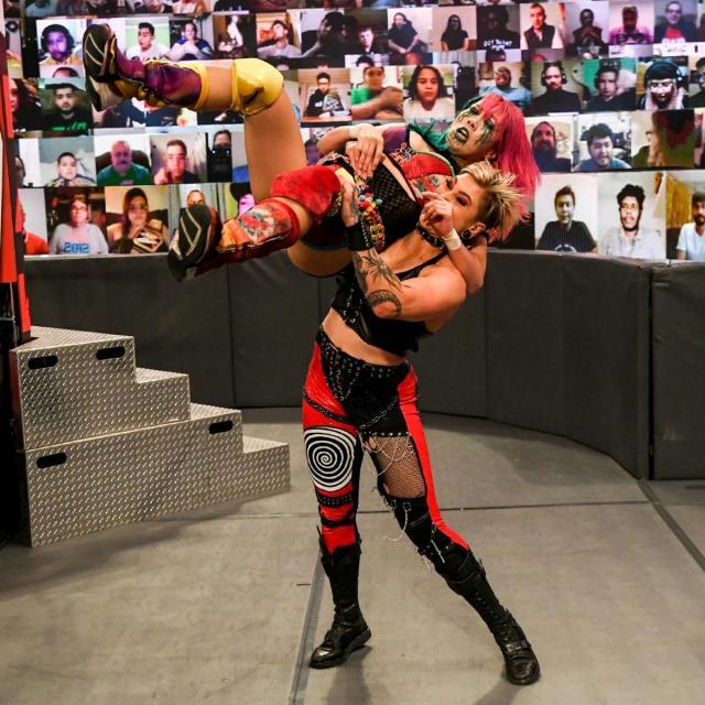 Rhea Ripley slams Asuka at ringside