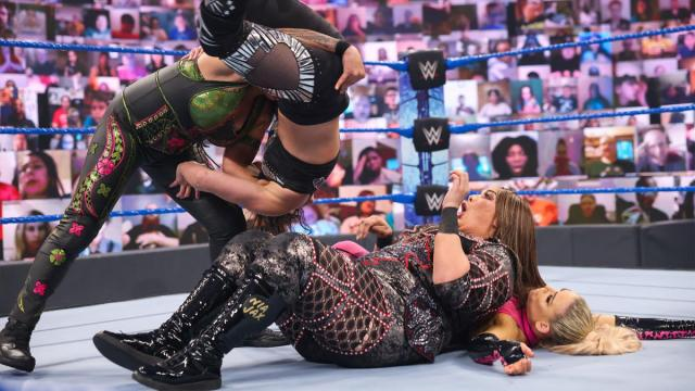 Tamina slams Shayna Baszler onto Nia Jax while she's pinning Natalya
