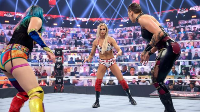 Asuka, Rhea Ripley, and Charlotte Flair at the start of the match