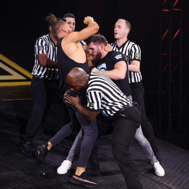 Officials try to separate Pete Dunne and Johnny Gargano