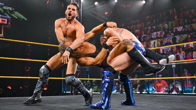 Johnny Gargano, Kyle O'Reilly, and Pete Dunne mid-match