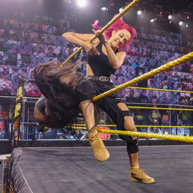 Dakota Kai kicks Ember Moon out of the ring