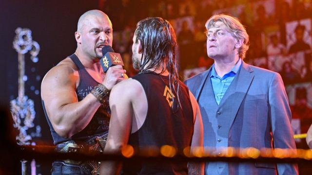 William Regal looks on as Karrion Kross and Adam Cole argue