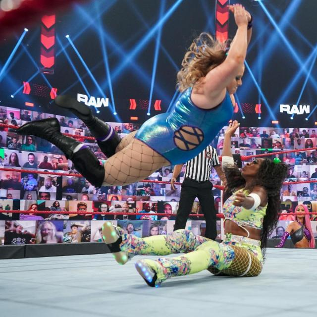 Piper Niven delivers a low crossbody to Naomi