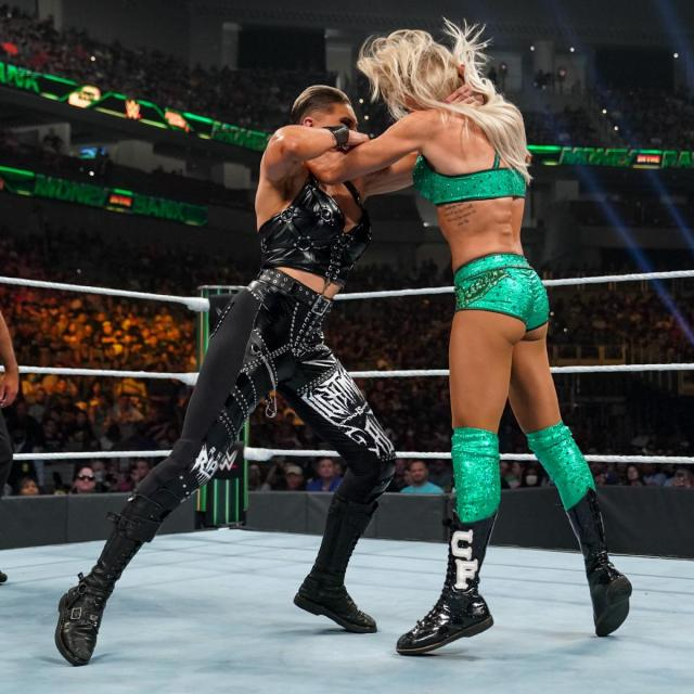 Rhea Ripley and Charlotte Flair lock up