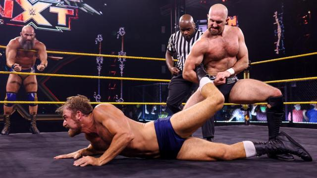 Oney Lorcan with Timothy Thatcher in an ankle lock. Tommaso Ciampa in the background.