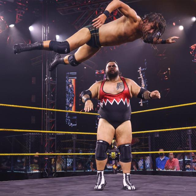 Adam Cole takes a Bronson Reed assisted flight