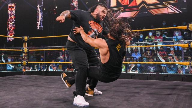 Adam Cole gets bulldozed by Bronson Reed