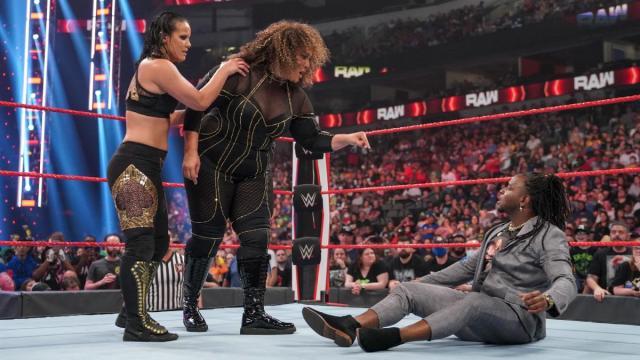 Shayna Baszler and Nia Jax stand over Reginald