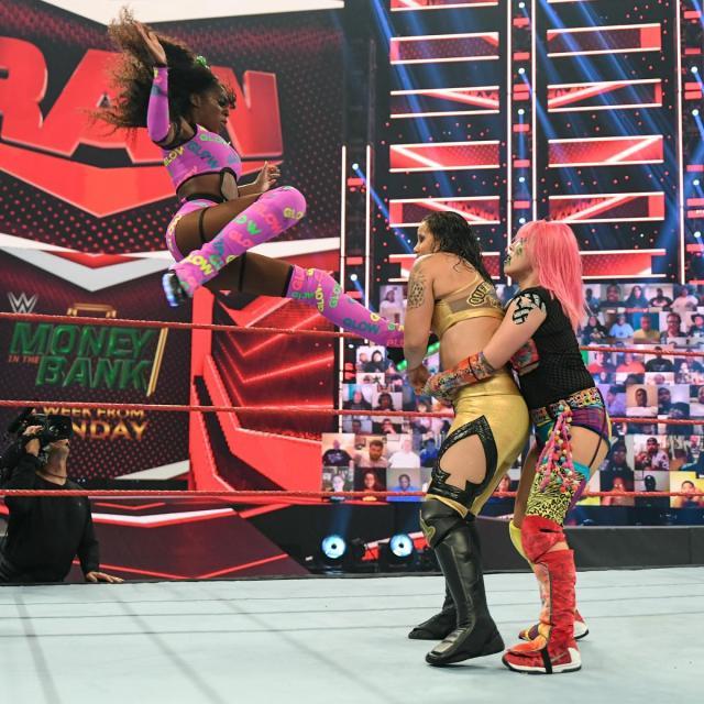 Naomi flies onto Shayna Baszler held by Asuka
