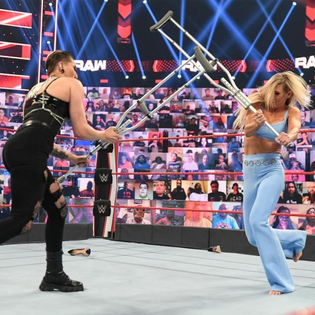 Rhea Ripley and Charlotte Flair have a crutch fight