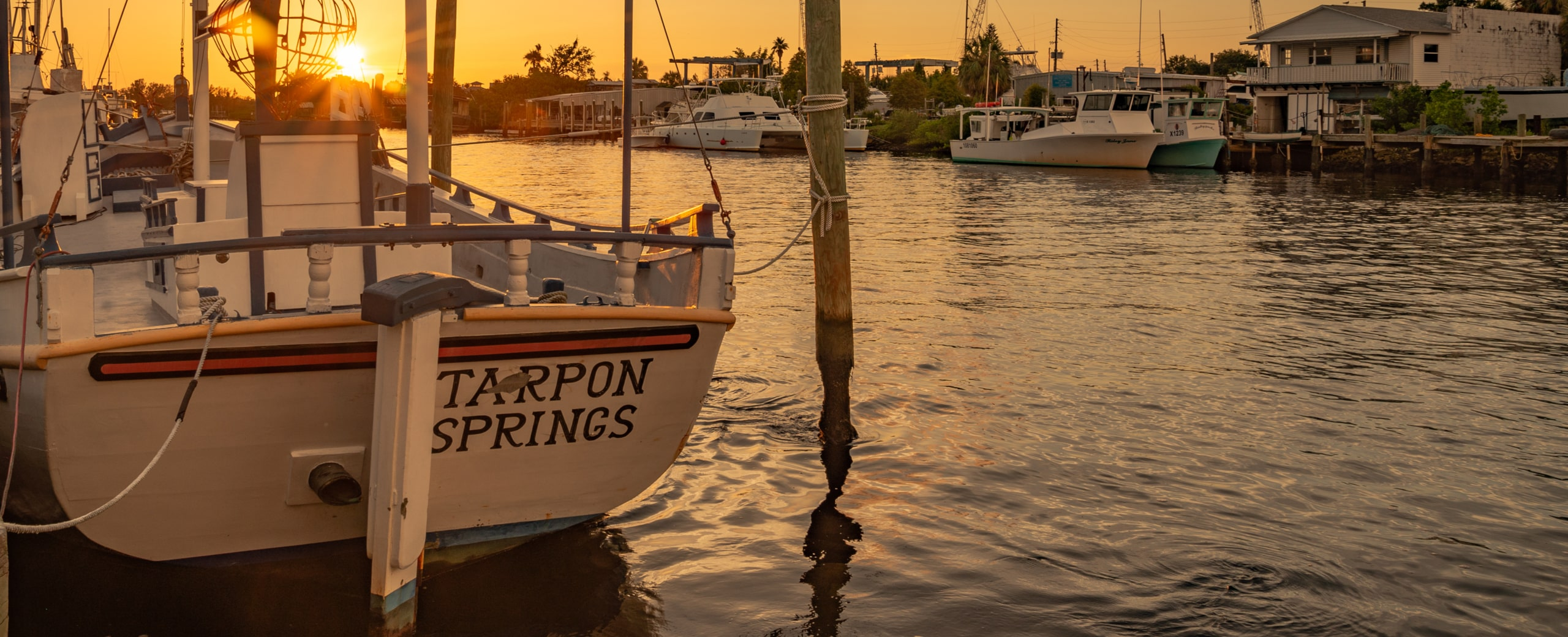 tarpon springs boat at sunset