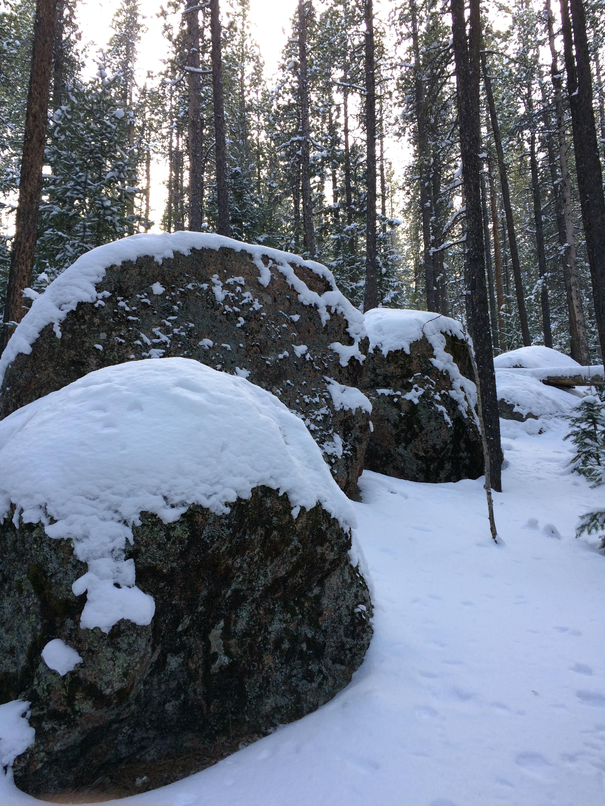 Snow blanketed boulders.