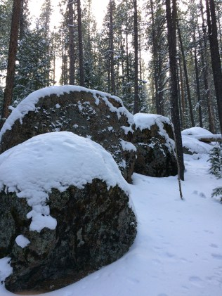 Snow blanketed boulders.