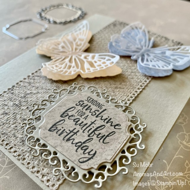 By Su Mohr for GDP285; Click aromasandart to go to my web site for details! Featuring: Brilliant Wings Dies, Ornate Layers Dies, Ornate Frames Dies, Sand & Sea Designer Paper, Welcoming Window Stamp Set; #brilliantwings #butterflies #butterfliesoncards #birthdaycards #sand&sea #ornatelayers #ornateframes #welcomingwindow #handmadecards #handcrafted #diy #cardmaking #papercrafting #sumohr #aromasandart #tastefultextileembossing